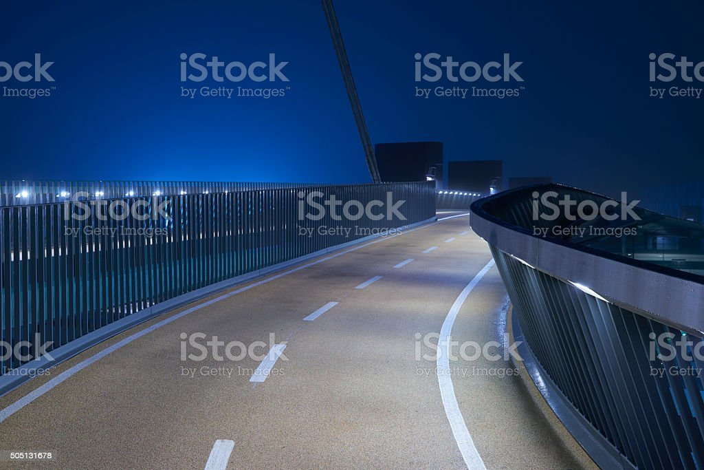 Elevated walkway at night stock photo