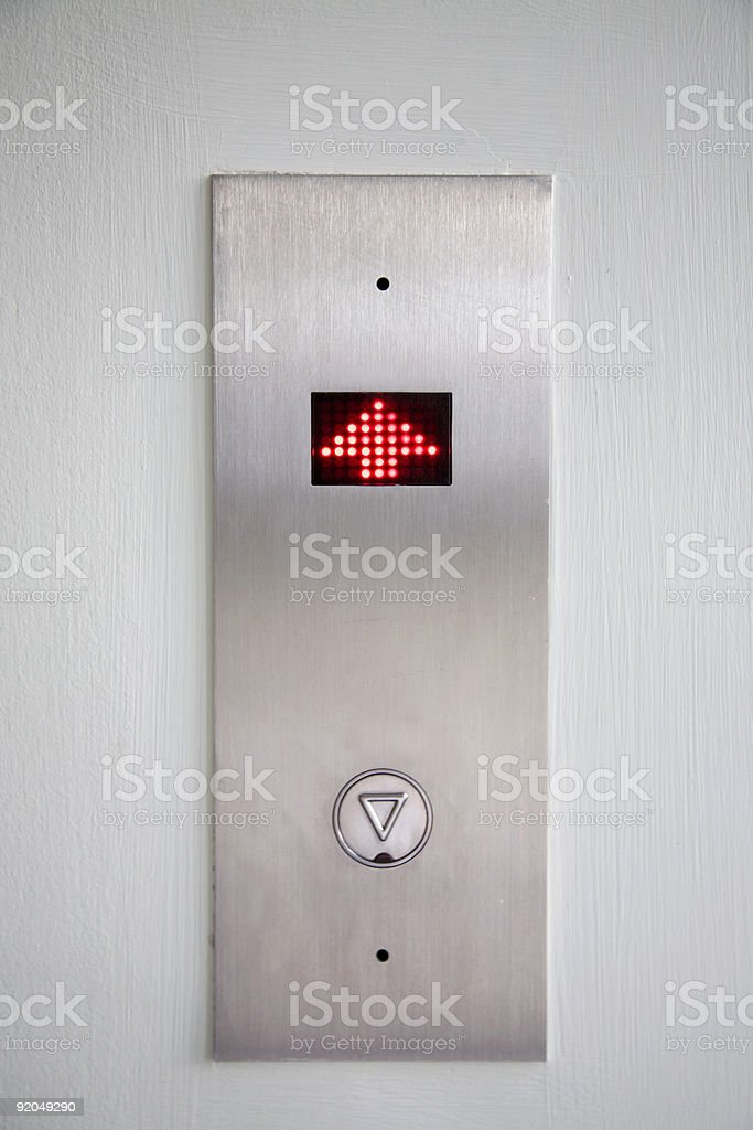 A very basic image of a elevator floor sign with the arrow pointing...