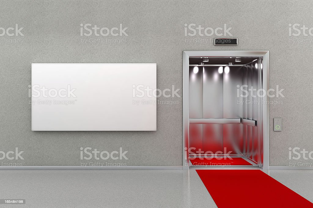 Elevator with red carpet and billboard royalty-free stock photo