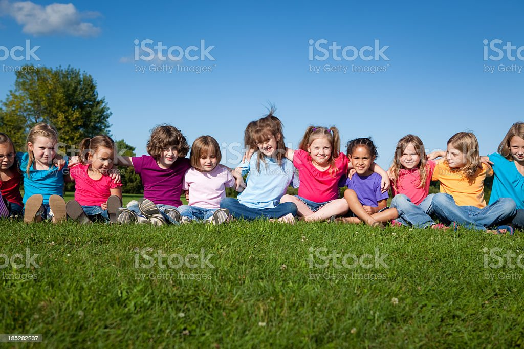 Eleven Happy Little Girls Sitting and Hugging One Another royalty-free stock photo