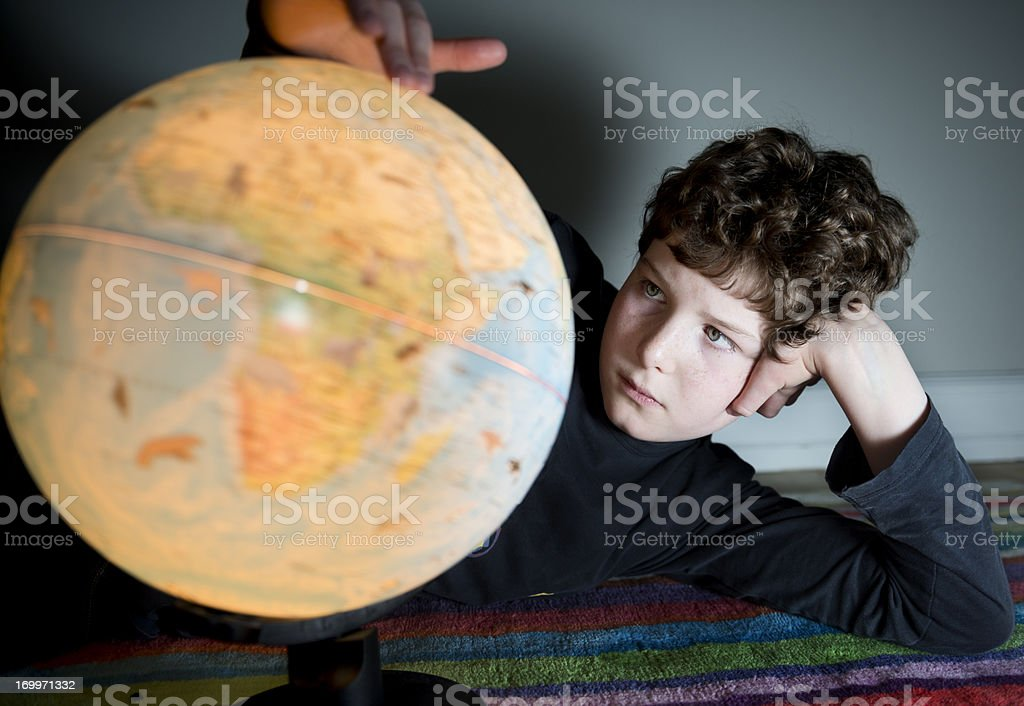 Eleven Year Old Boy Looking at a Globe royalty-free stock photo