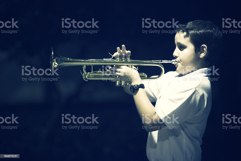 eleven years old kid playing the trumpet royalty-free stock photo