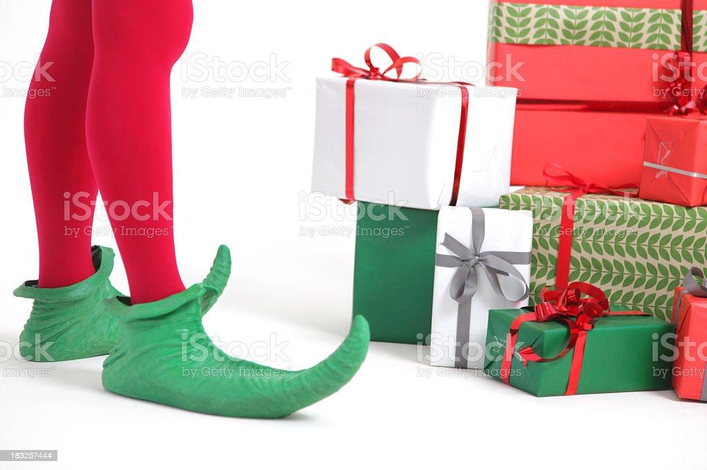 Elf with christmas presents stock photo
