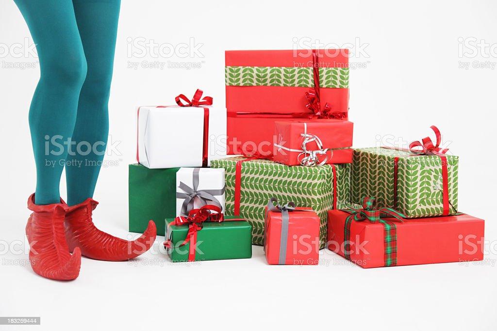 Elf with presents stock photo