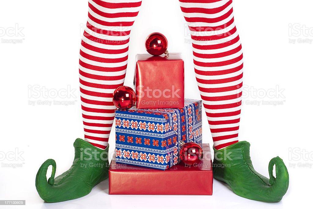 Elf's legs with presents stock photo