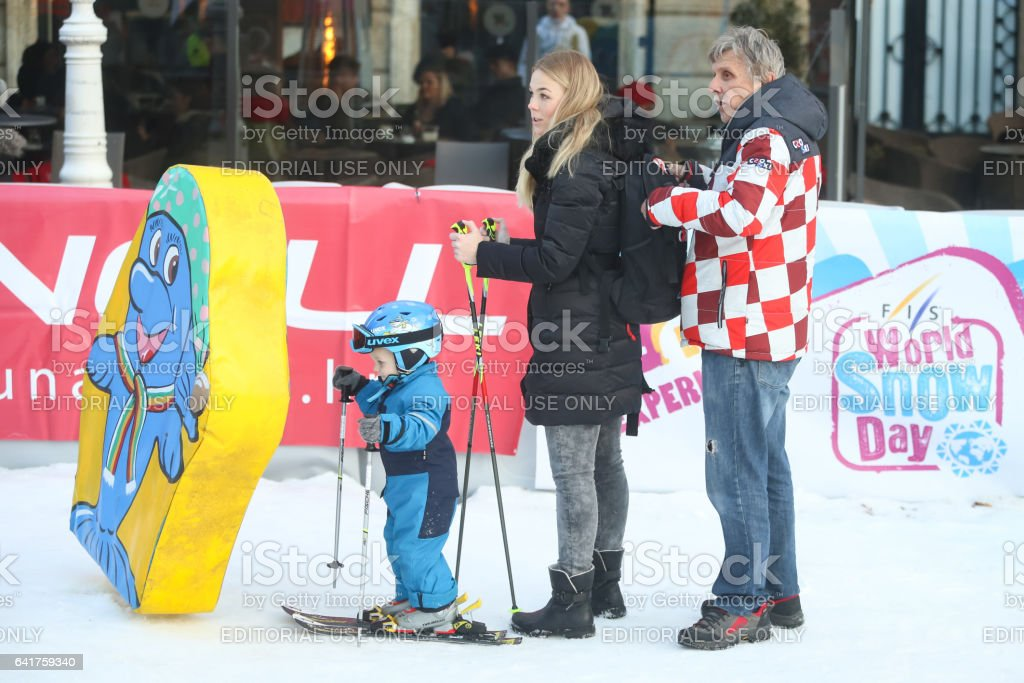 Elin Kostelic with son on ski slope stock photo