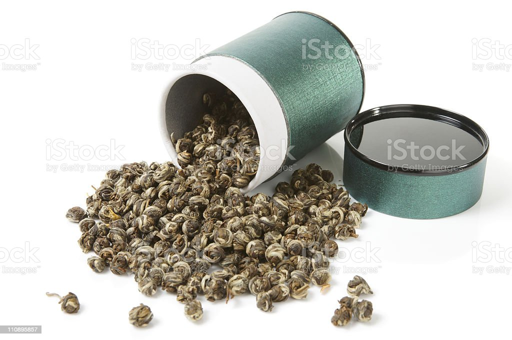 Elite oolong tea spilled from the container royalty-free stock photo