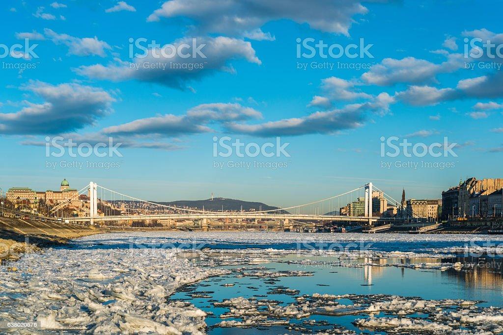 Elizabeth bridge and the icy Danube river stock photo