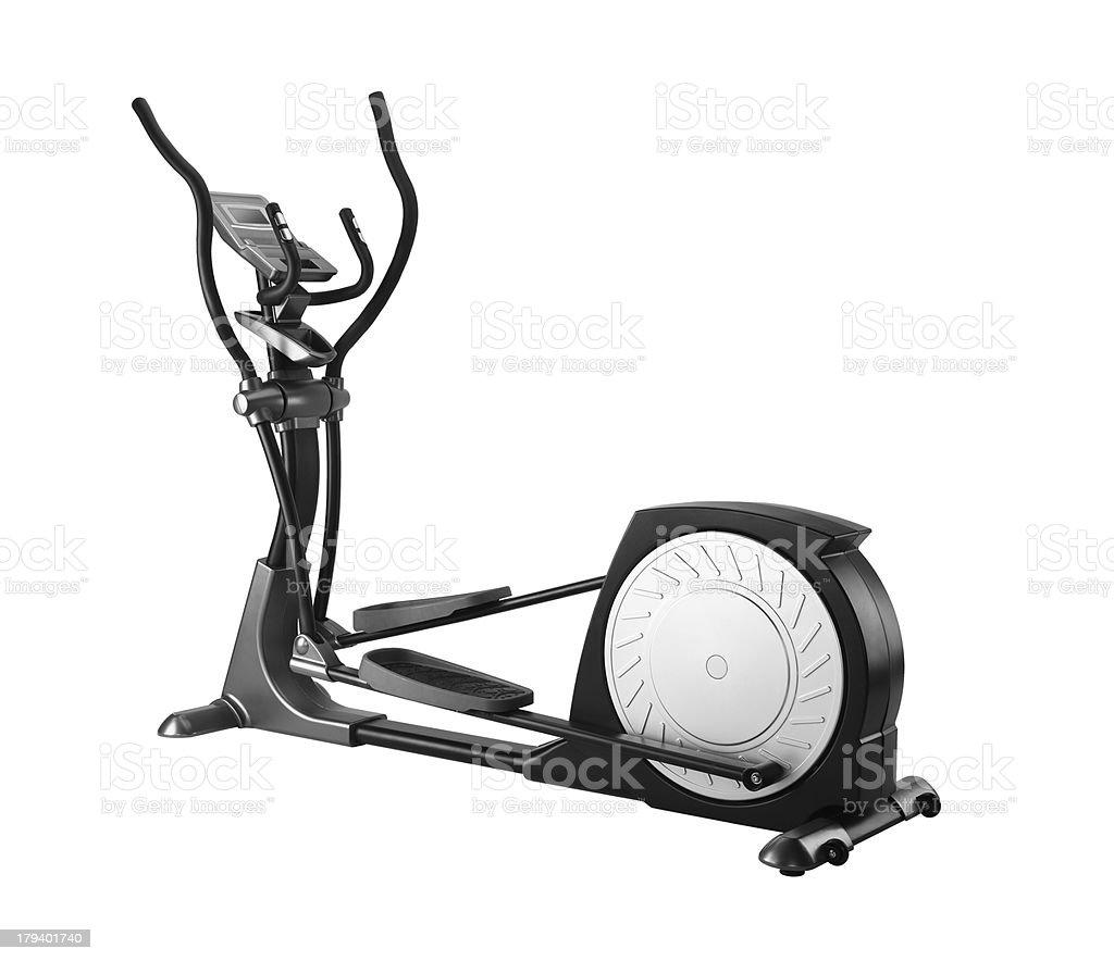 Elliptical gym machine over white background stock photo