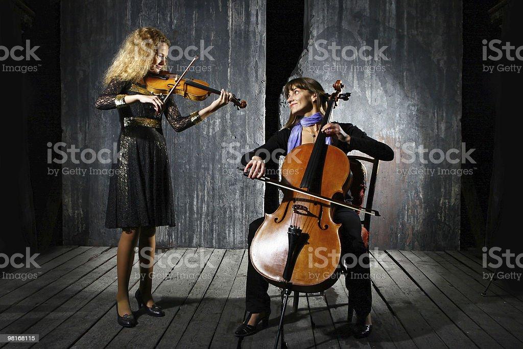 Сello and violin musicians stock photo