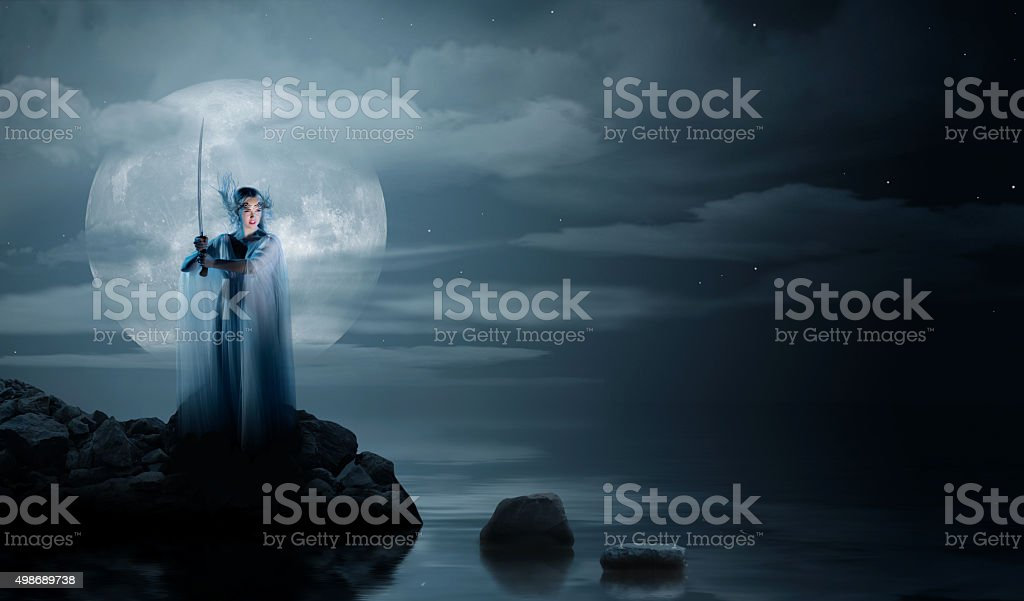 Elven girl on sea coast stock photo