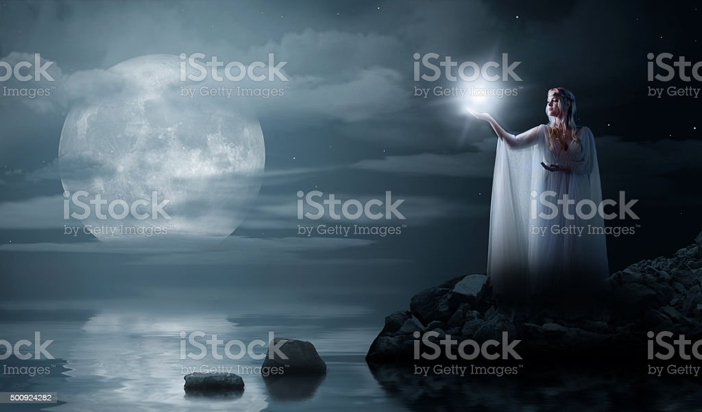 Elven girl with star isolated on sea coast stock photo