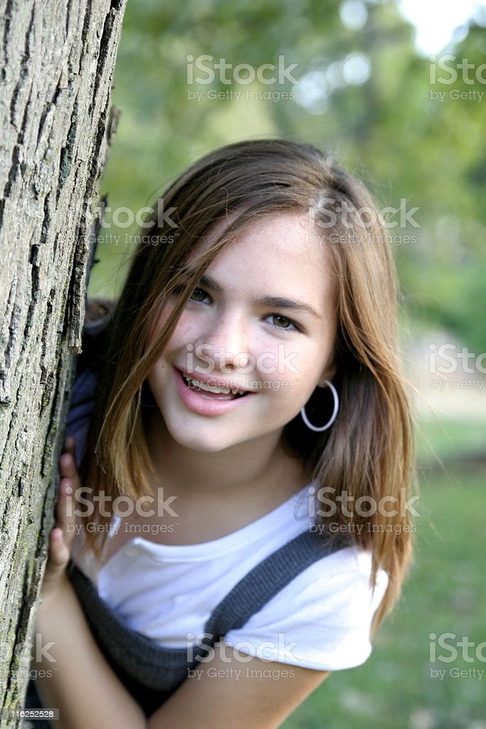 Elyce - Hiding by a Tree royalty-free stock photo
