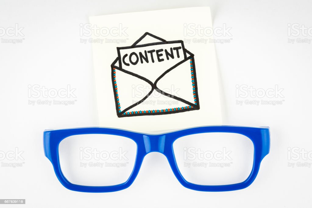 Email content marketing concept with blue eyeglasses on white background stock photo