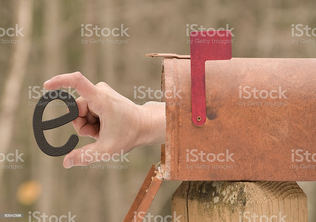 E-Mail Digital Comp with hand in mailbox stock photo