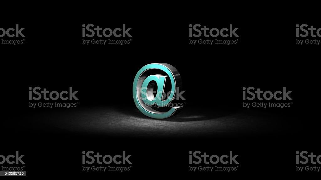 AT E-mail icon  on black illuminated with spotlight stock photo