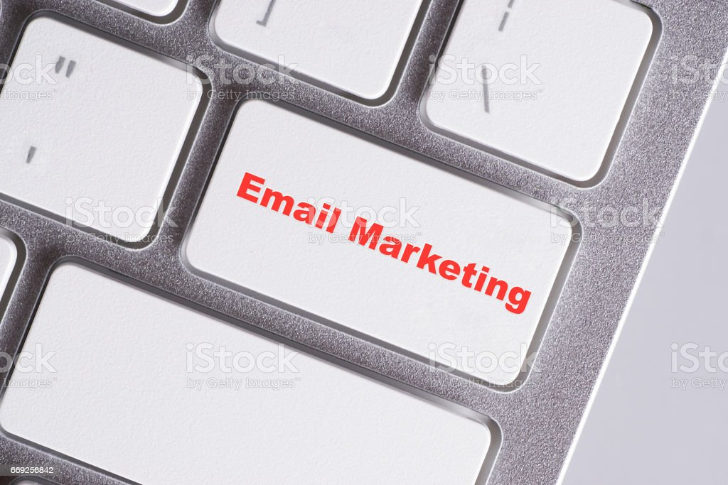 'Email marketing' red words on white keyboard - online, education and business concept stock photo