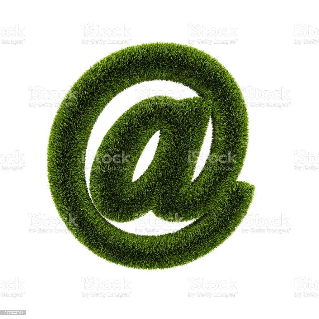 e-mail symbol covered grass stock photo