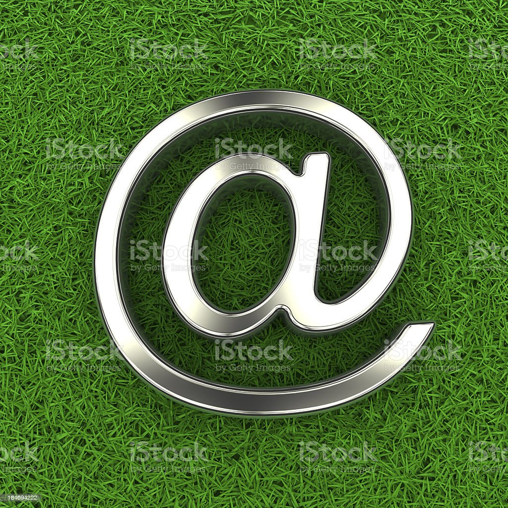 E-mail symbol on grass royalty-free stock photo