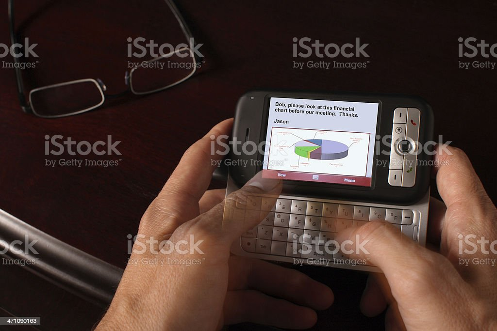 E-mailing on a PDA royalty-free stock photo