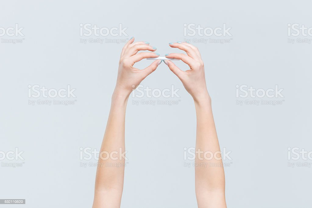 emale hands holding cigarette stock photo