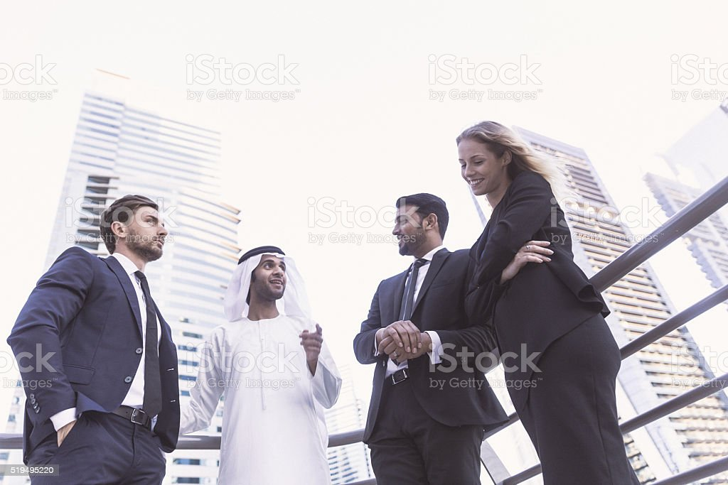 Emarati Businessman Discussing Middle Eastern Business Prospects stock photo