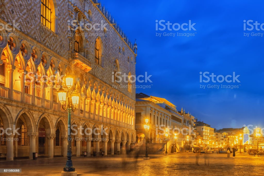 Embankment of the Grand Canal and the Doge's Palace (Palazzo Ducale) in night time, Venice. stock photo