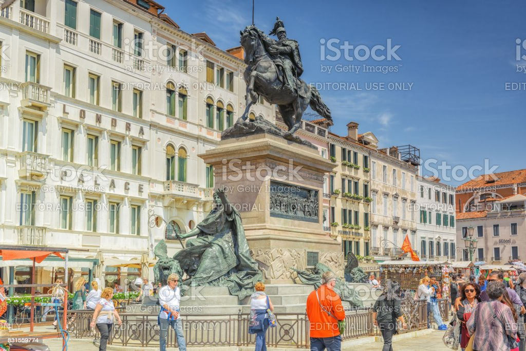 Venice,  Italy - May 12, 2017 : Embankment of the Grand Canal with tourist near  Doge's Palace. The Victor Emmanuel II Monument( Monumento Nazionale a Vittorio Emanuele II). stock photo