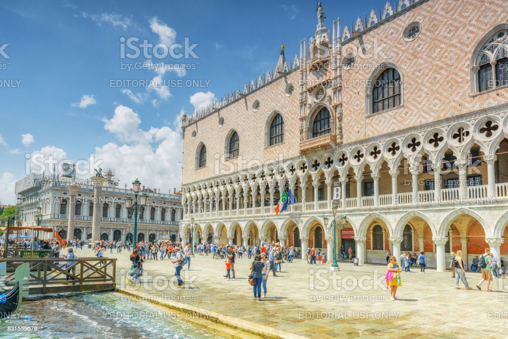 Venice,  Italy - May 12, 2017 : Embankment of the Grand Canal with tourists and the Doge's Palace (Palazzo Ducale). stock photo