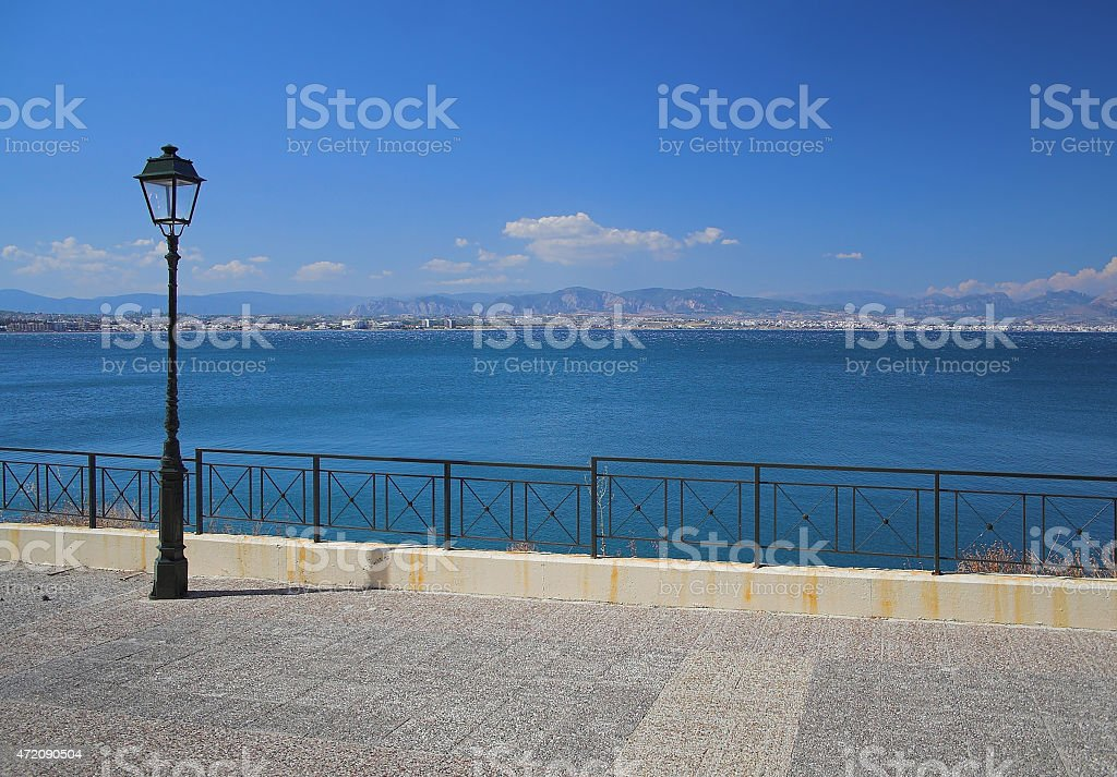 Embankment with lamps. Corinthian gulf, Lutraki, Greece stock photo