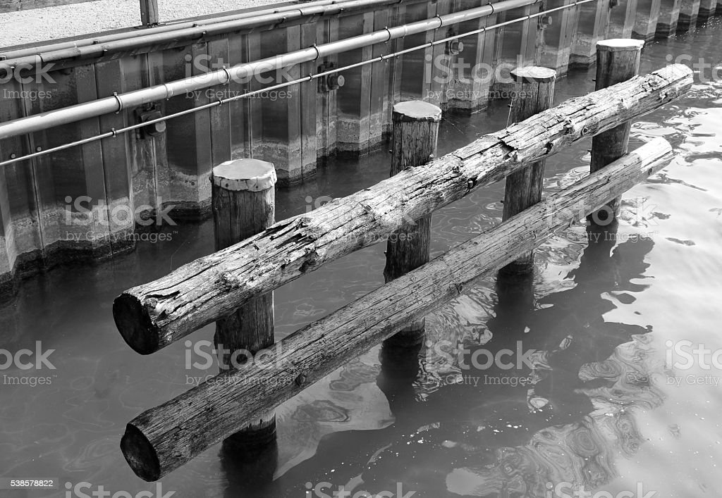 Embankment wooden fence in black and white stock photo