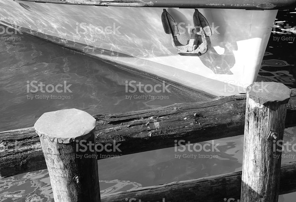 Embankment wooden fence with part of ship and anchor. stock photo