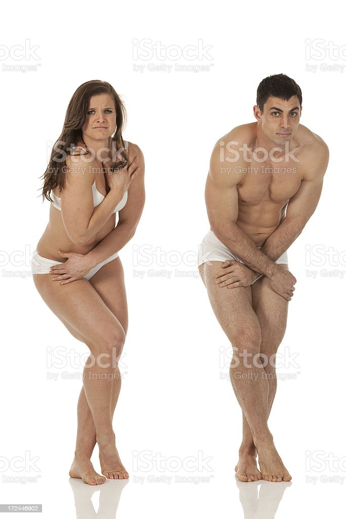 Embarrassed couple in undergarments royalty-free stock photo