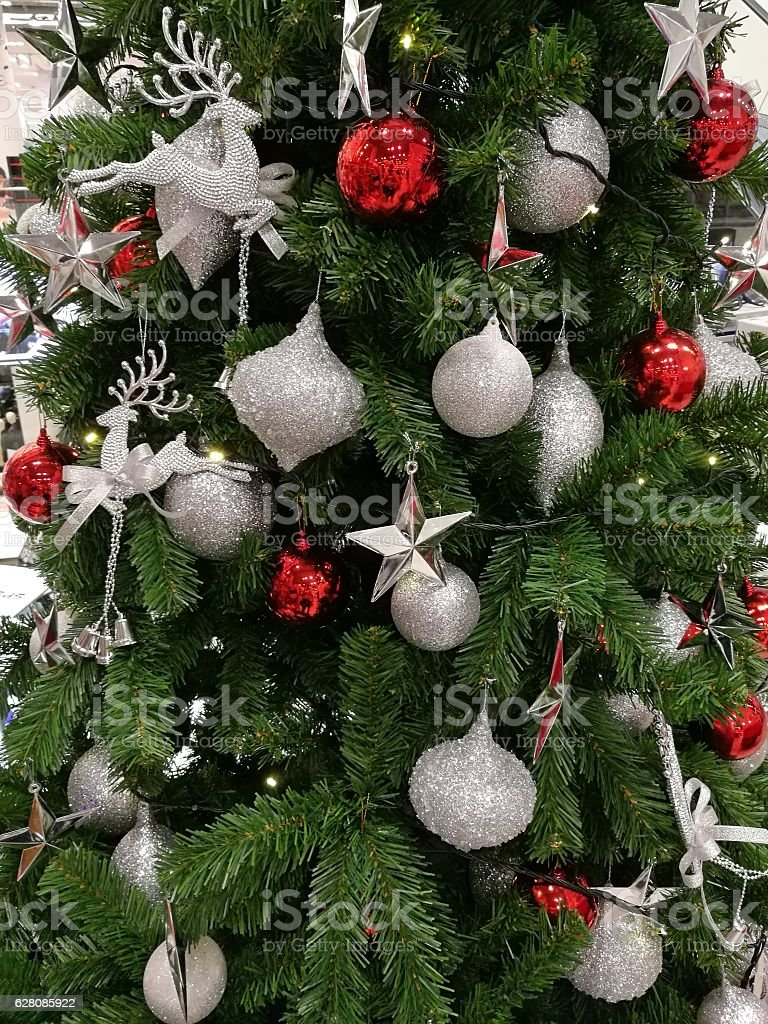 Embellished Christmas tree decoration glitter silver ornaments and red ball stock photo