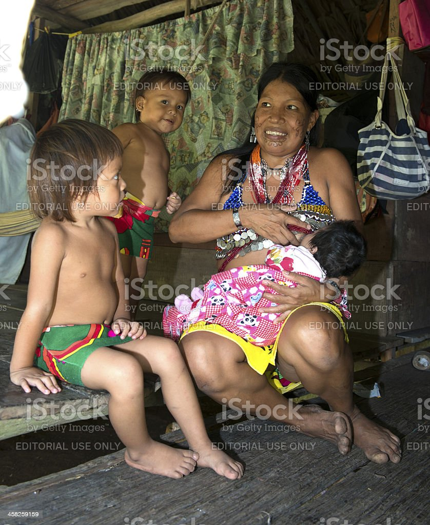 Embera Family in their cottage stock photo