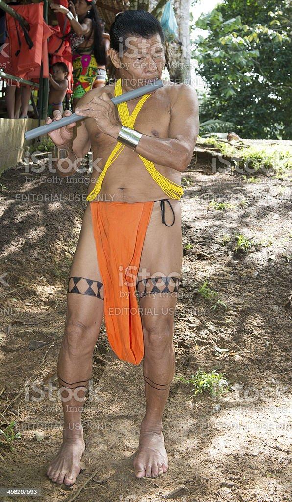 Embera man  playing flute stock photo