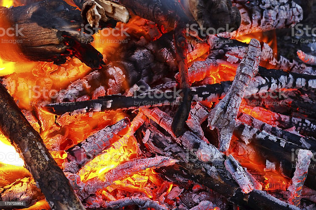 Embers glowing in blazing fire royalty-free stock photo