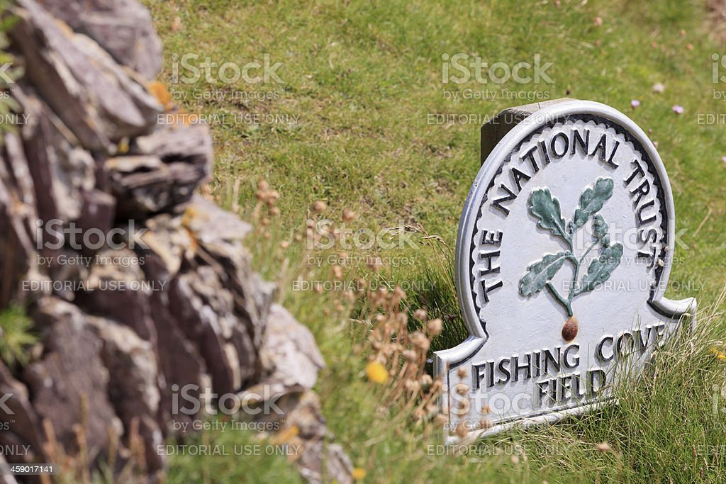 emblem of the National Trust at Fishing Cove Field royalty-free stock photo
