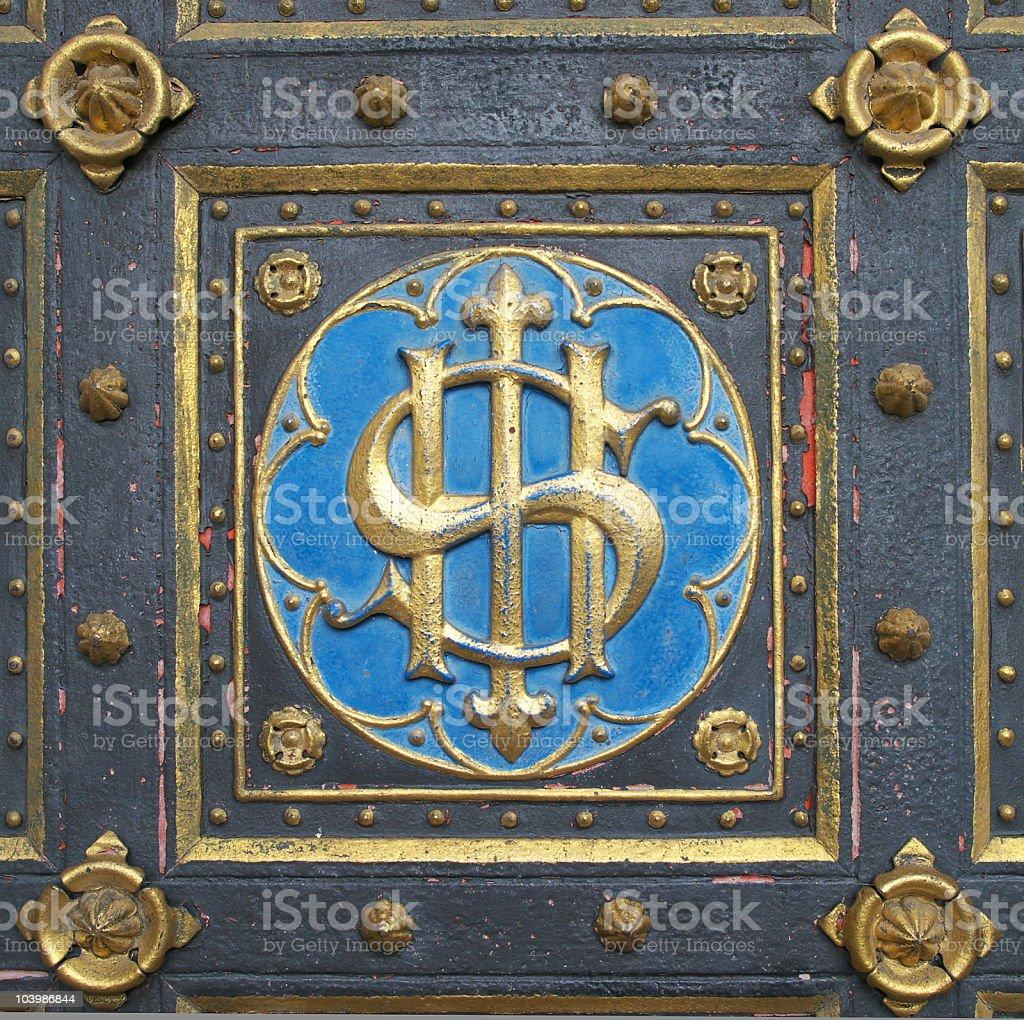 Emblem on doors of church royalty-free stock photo