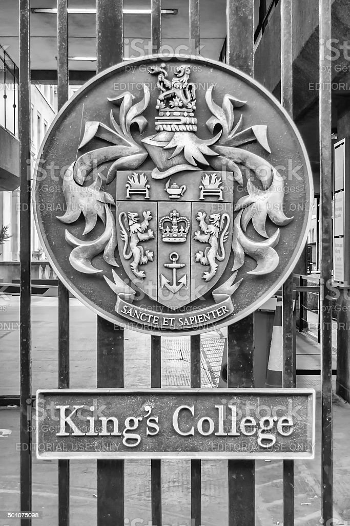 Emblem on the entrance gate of King's College in London stock photo
