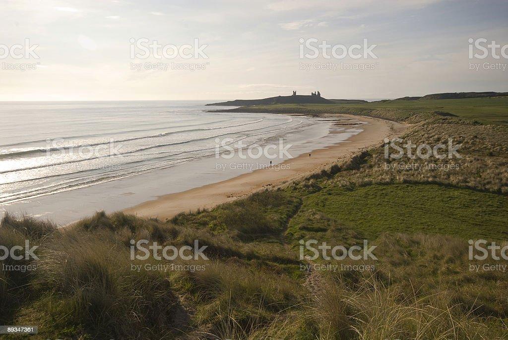Embleton Bay and Dunstanburgh Castle royalty-free stock photo