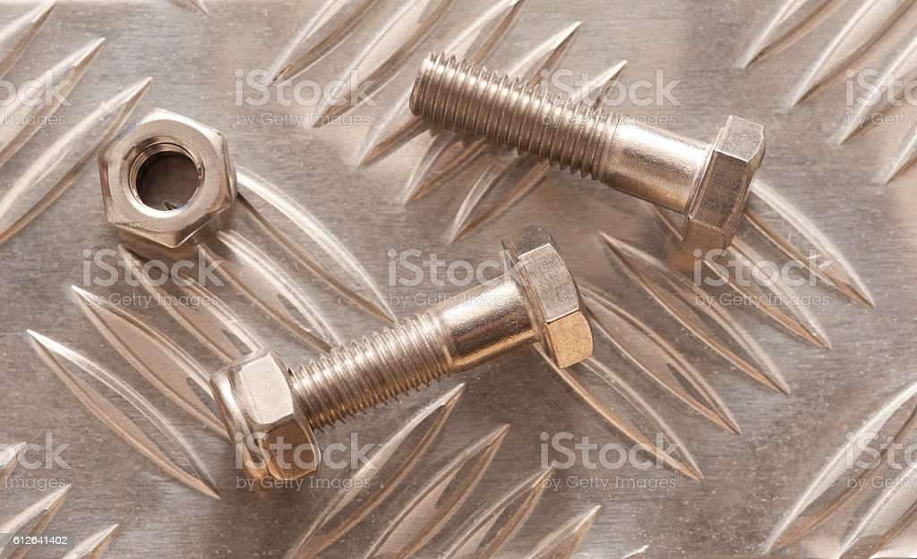 Embossed metal sheet with nuts and bolt stock photo