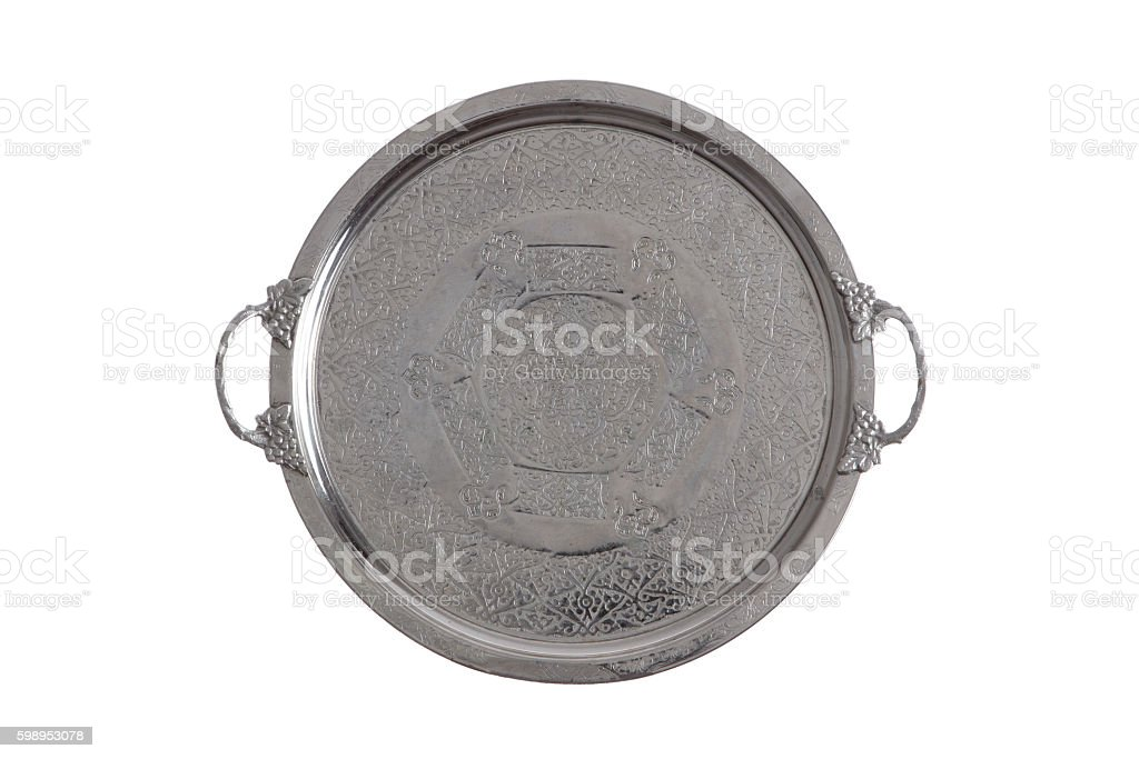 Embossed round silver coffee tray stock photo