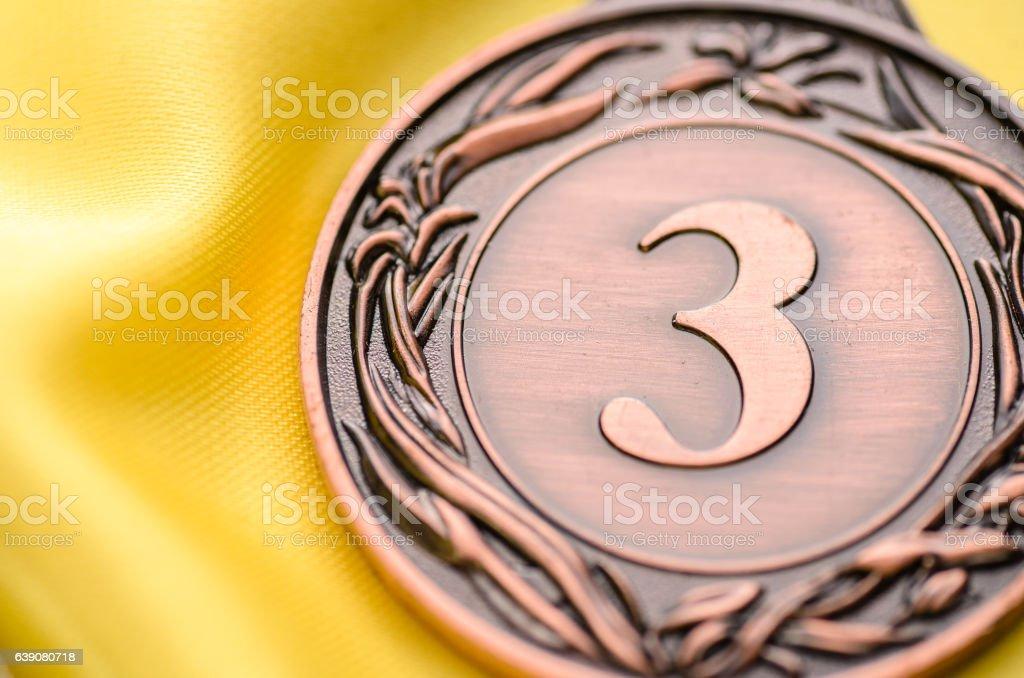 Embossed third place bronze medallion stock photo