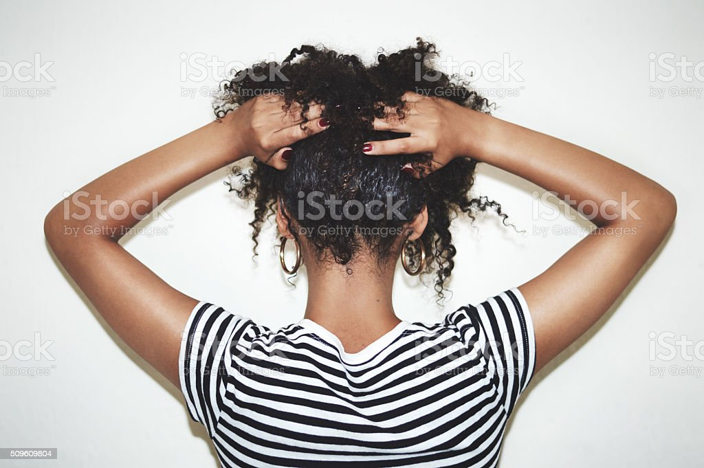 Embrace the curl stock photo