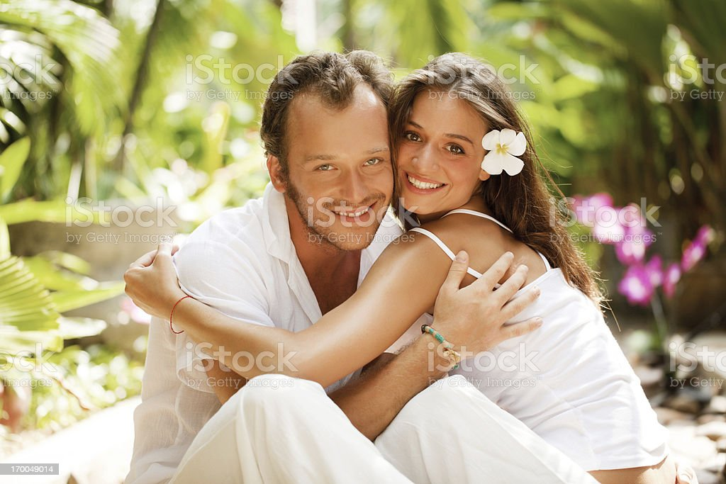 Embraced couple looking at the camera. royalty-free stock photo