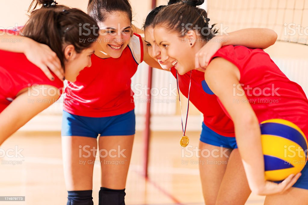 Embraced female volleyball winning team. royalty-free stock photo