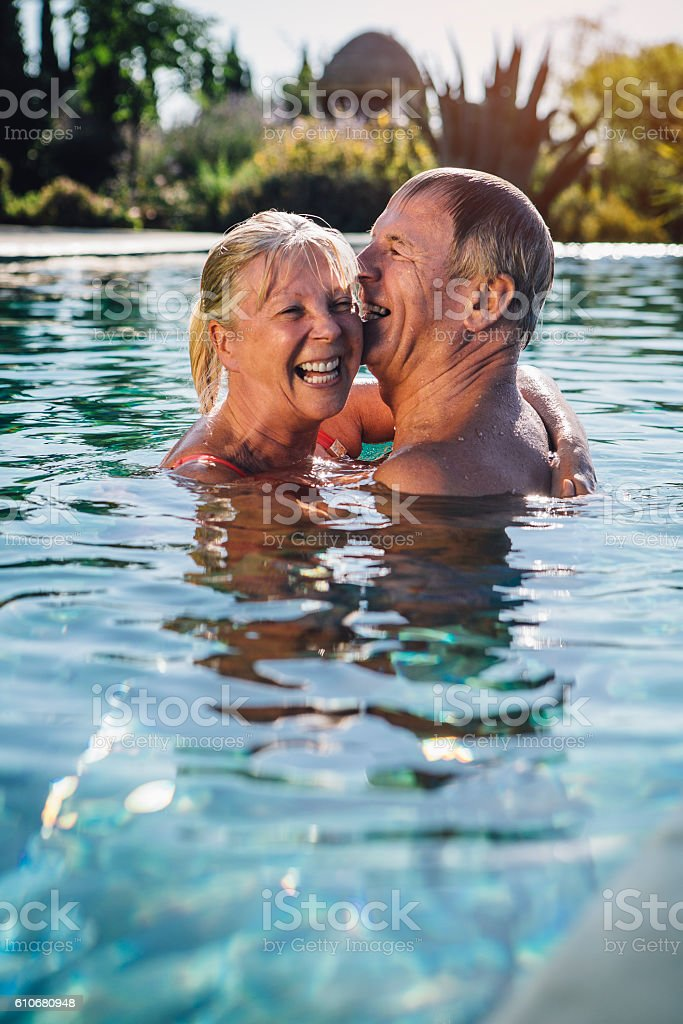 Embraced in the Swimming Pool stock photo