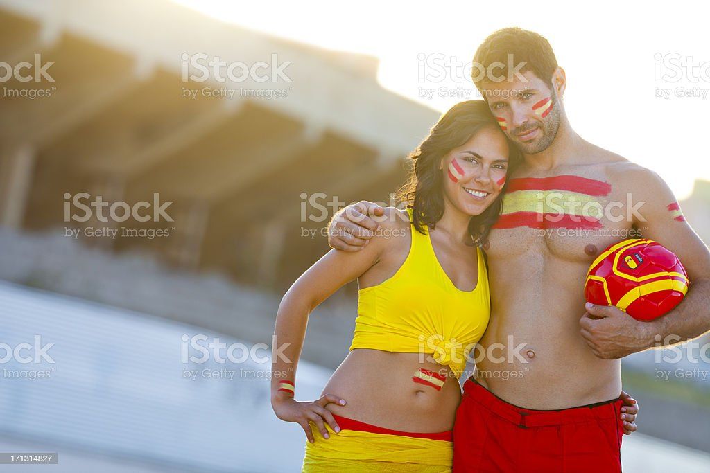 embracing couple as spanish football fans stock photo