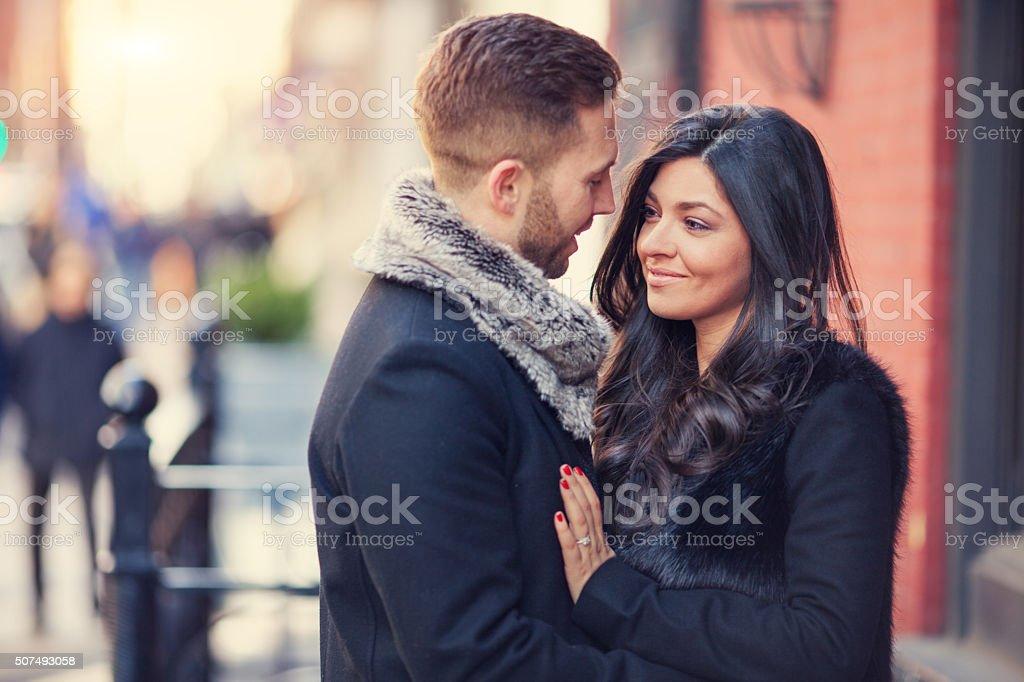 Embracing couple outdoors stock photo